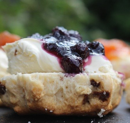 Scones with crème fraîche and jam on top