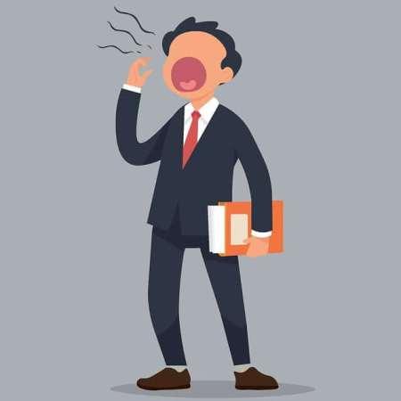 A cartoon man at work yawning heavily