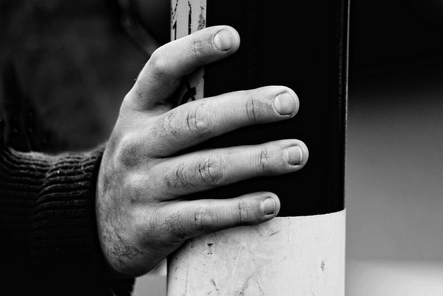 A hand in black and white showing the knuckles