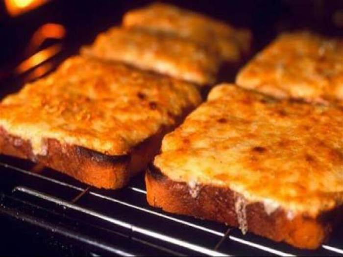 Cheese on toast under a grill