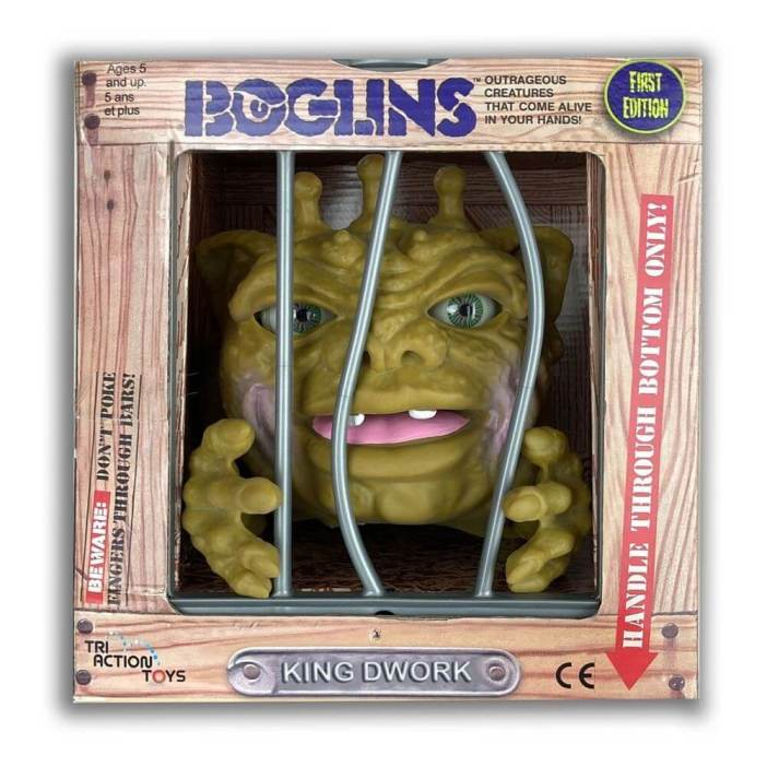 A Boglin toy in its cage box
