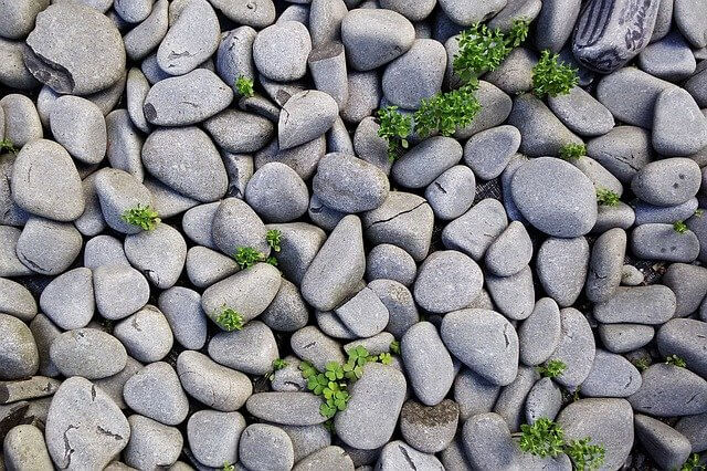 A large amount of grey pebbles on the ground