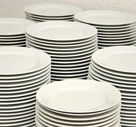 Clean dishes stacked up after being washed up