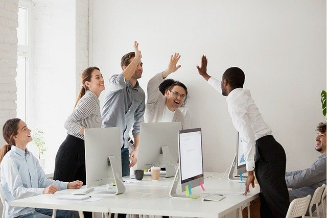 A team of colleagues performing a high five