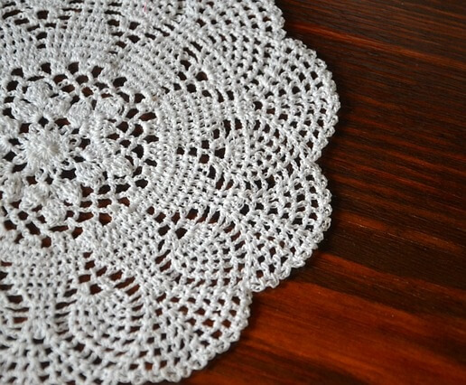 A white doily on a table