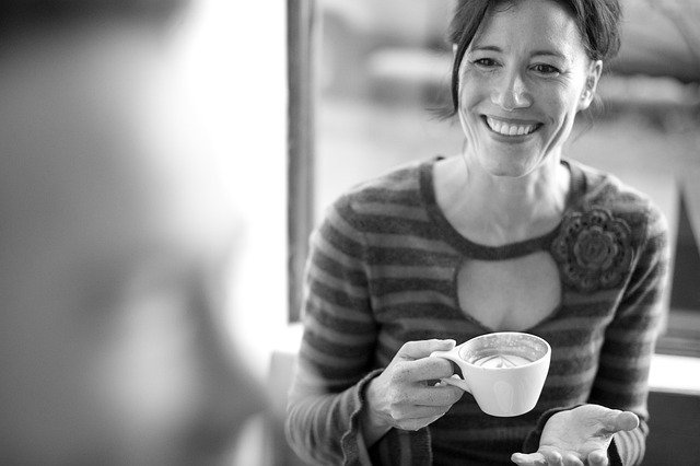 A woman on a date holding a coffee