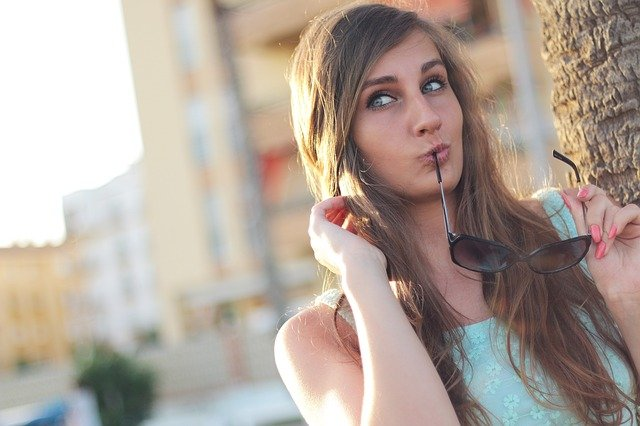 A woman posing and doing duck lips