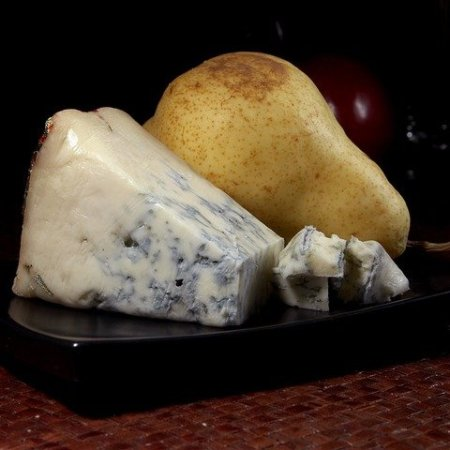 Gorgonzola cheese next to a pear